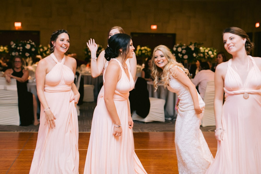 Bride and bridesmaids dancing at White Oaks Wedding Reception