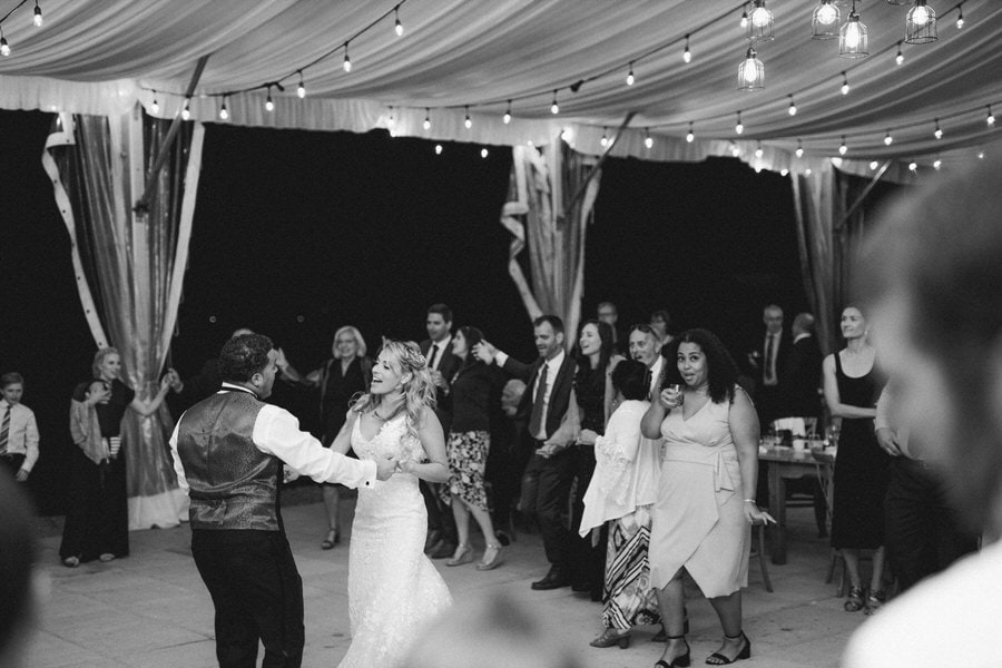 Bride & Groom Dancing at outdoor Tent Reception