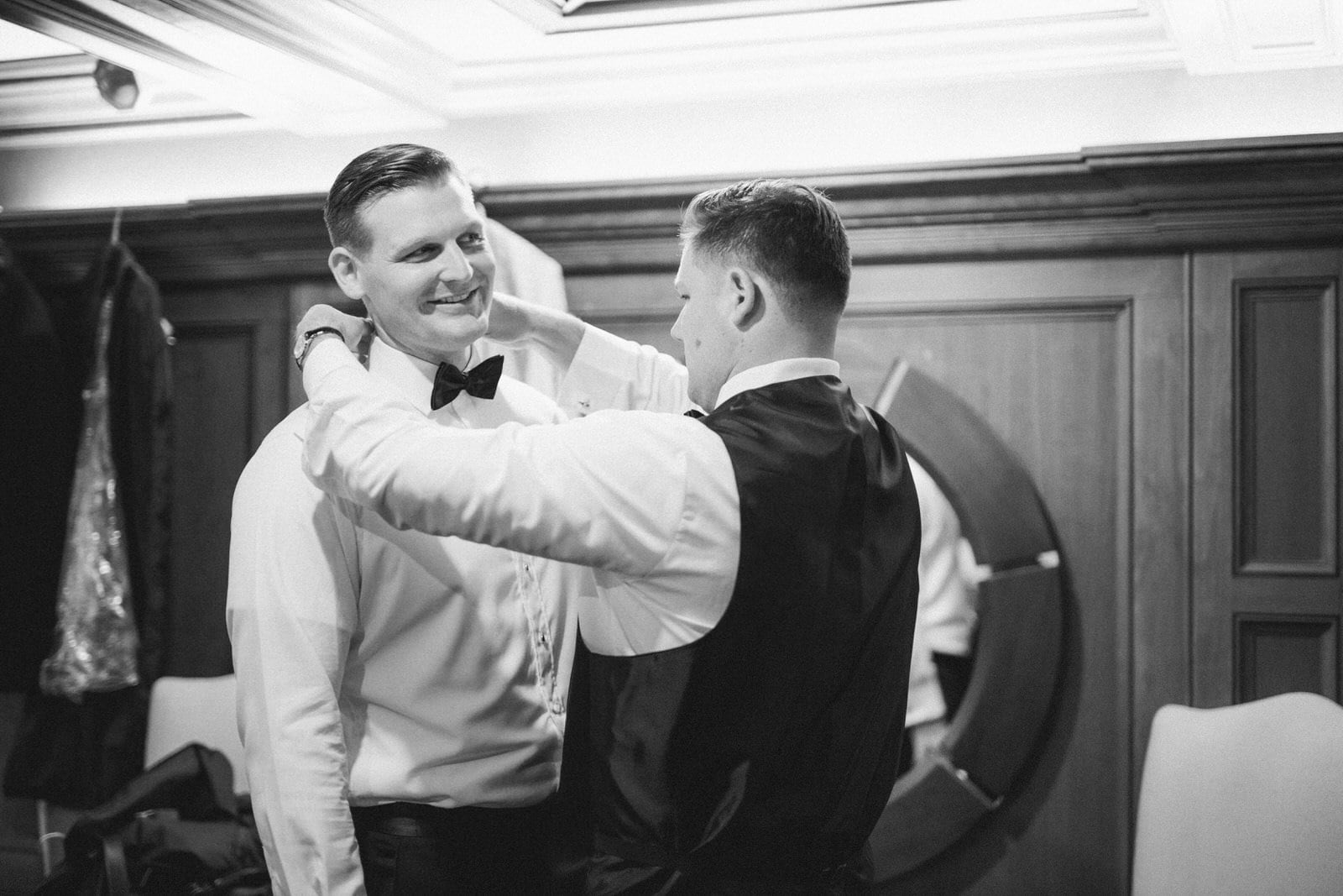 Black & White Photo of Groom Getting Ready for his wedding at Pillar & Post