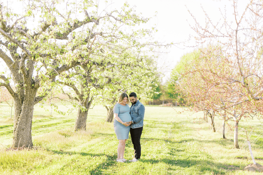 Interracial couple maternity photo in the blooms