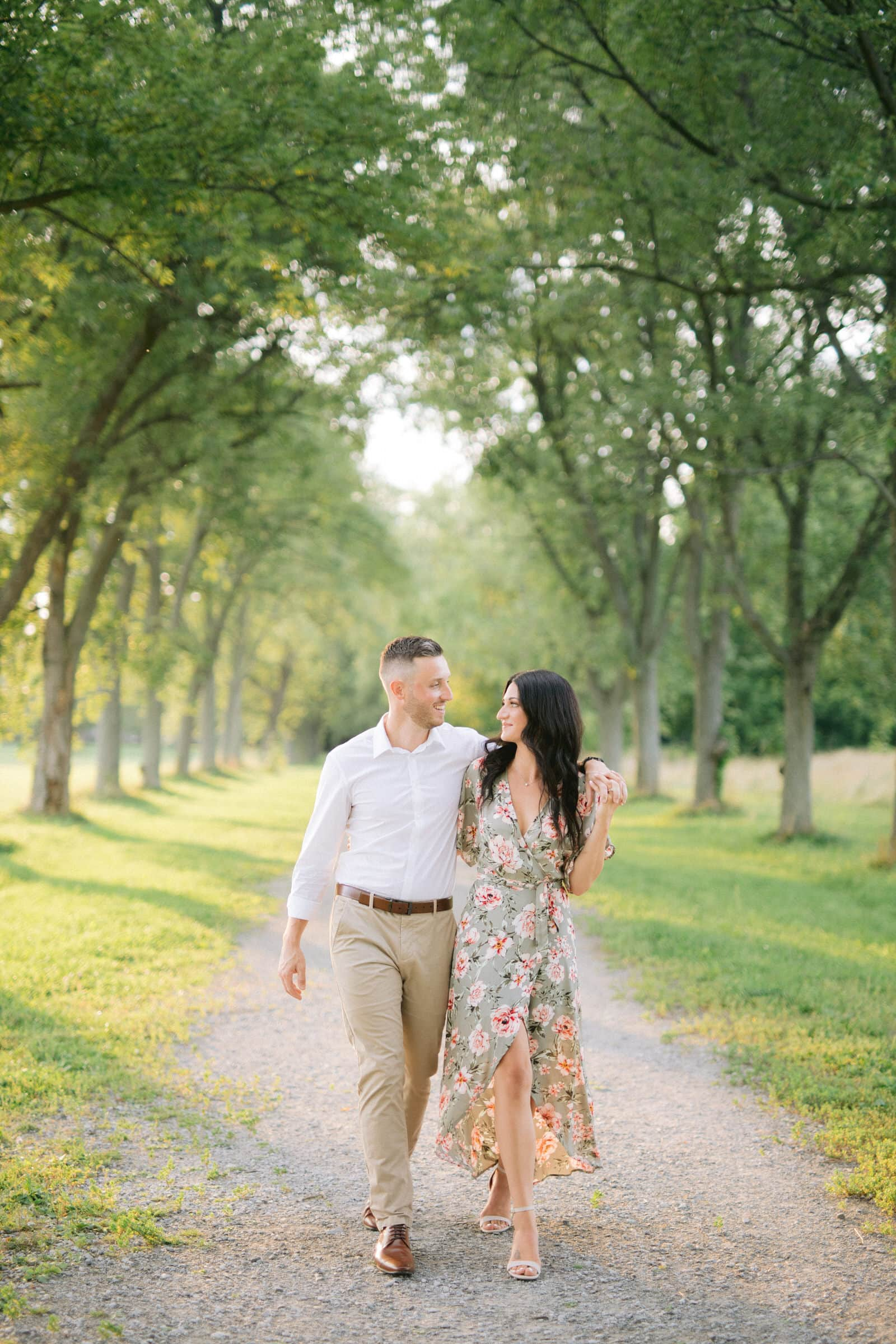 Engagement photos of couple walking at the barracks in Niagara on the lake