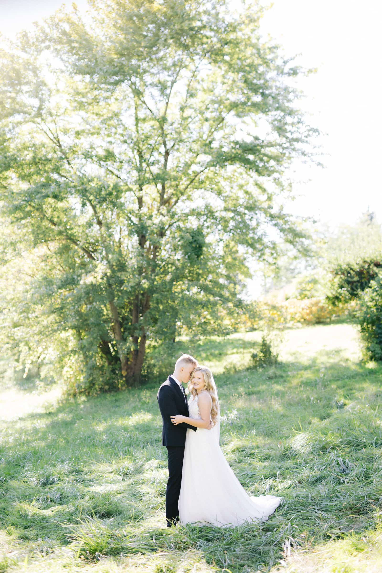 Bride & Groom holding each other at Woodland Weddings