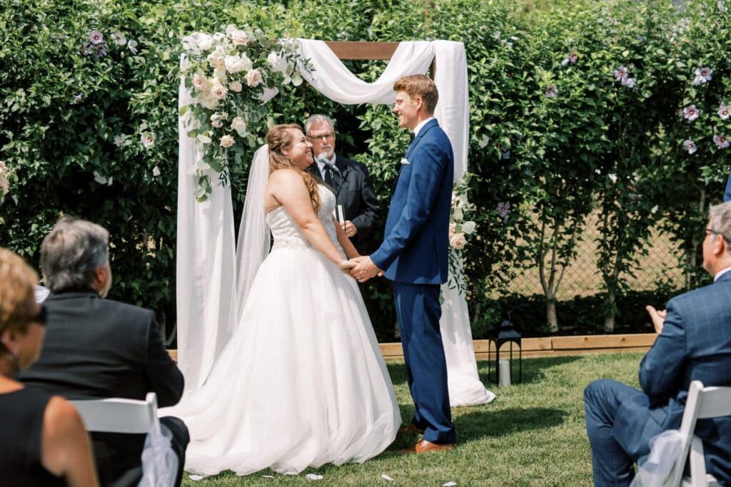 Bride & groom Intimate wedding first kiss reaction