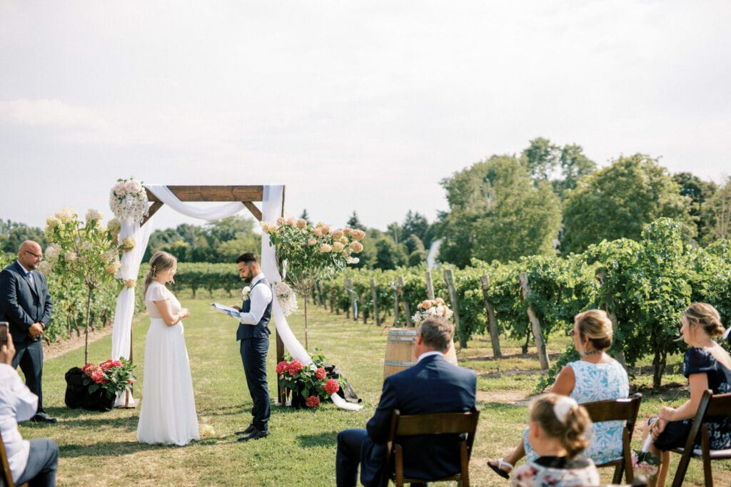 Bride & Groom Reading Vows at Intimate Wedding in Niagara on the Lake